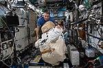 ISS-59 David Saint-Jacques moves a spacesuit inside the Destiny lab.jpg