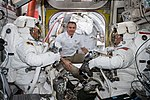 ISS-59 EVA-1 (a) David Saint-Jacques with spacewalkers inside the Quest airlock.jpg