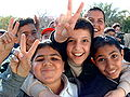 Iraqi boys giving peace sign.jpg