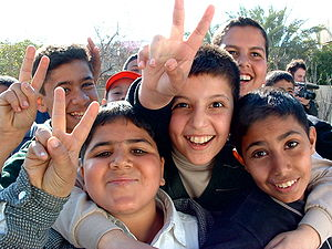 Iraqi boys giving peace sign Iraqi boys giving...