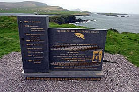 Telegraph Field, Valentia Island: Site of the earliest message sent from Ireland to America. In October, 2002, a memorial to mark the laying of the transatlantic cable to Newfoundland was unveiled on top of Foilhomerrum Cliff. Made of Valentia slate and designed by local sculptor Alan Hall, the memorial marks the history of the telegraph industry to the island from 1857 forward.