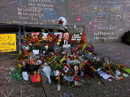 An impromptu memorial set up at Nathan Phillips Square shortly after his death. Jack Layton memorial in Nathan Phillips Square (1).jpg