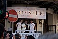 Jack Lowden, Vangelis, and James McArdle watch the Olympic Torch Relay from the Gielgud Theatre, 26 July 2012.jpg