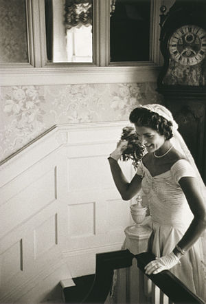 Jacqueline Kennedy throwing the bouquet at her...