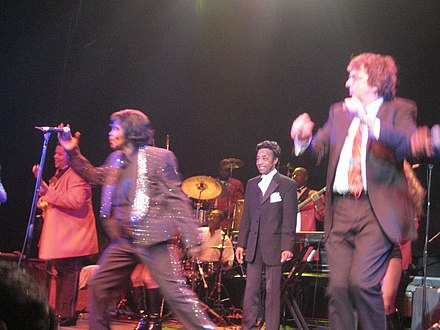Brown's most famous MC was Danny Ray (center), who was with him for over 30 years. Jamesbrown2.jpg