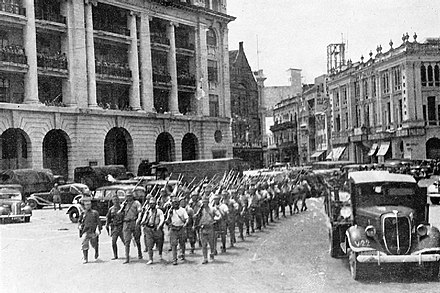 Victorious Japanese troops march through the city center of Singapore following the city's capture in February 1942 (Photo from the Imperial War Museum) JapaneseMarchSgpCity.jpg