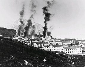 Buildings burning after the first Japanese attack, 3 June 1942.