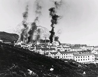 Arkansas National Guard and World War II - Buildings burning after the first enemy attack on Dutch Harbor, June 3, 1942.