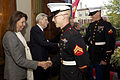 Jeanne Vander Myde, left, the wife of retired U.S. Sen. John Warner, center rear, a former secretary of the Navy and the Evening Parade guest of honor, exchanges greetings with a U.S. Marine Corps corporal 130503-M-LU710-044.jpg