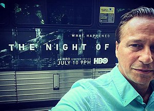 Jeff Wincott - Actor Jeff Wincott stands in front of a bus advertising the HBO mini-series, The Night Of, in which he co-starred.