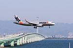 Jetstar Japan, GK352, Airbus A320-232, JA13JJ, Arrived from Naha, Kansai Airport (17188000885).jpg
