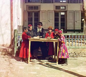 Demographics of Uzbekistan - Jewish children with their teacher in Samarkand. Early color photograph from Russia, created by Sergei Mikhailovich Prokudin-Gorskii as part of his work to document the Russian Empire from 1909 to 1915.