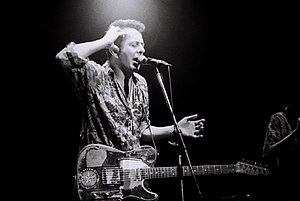 Joe Strummer - Strummer, backing with the Pogues in Japan. Photo: Masao Nakagami