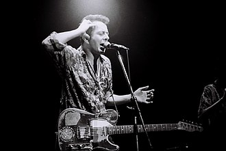 Joe Strummer - Strummer, backing with the Pogues in Japan.