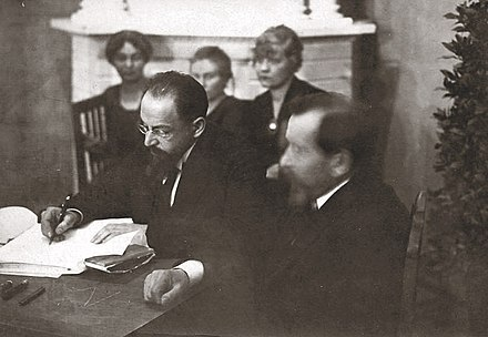 Signing the Treaty of Tartu. Adolf Joffe (Soviet Russia, left). Joffe signing the Treaty of Tartu.jpg