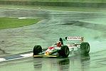 Johnny Herbert - Lotus 107B during practice for the 1993 British Grand Prix (33686691855).jpg