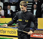 Judd Trump waiting to take a shot
