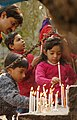 Kids lighting the Candle in front of Sacred Heart Cathedral near Gole Dak Khana on the eve of the Christmas, in New Delhi on December 24, 2006.jpg
