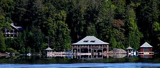Great Camps - The boathouse and one of the cottages at Knollwood Club on Lower Saranac Lake.
