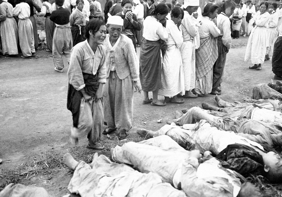 Koreans from Hamhung identify the bodies of some 300 political prisoners who were killed by the North Korean Army by being forced into caves which were subsequently sealed off so that they died of suffocation HD-SN-99-03167