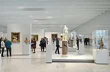visitors viewing the exhibits in the gallery