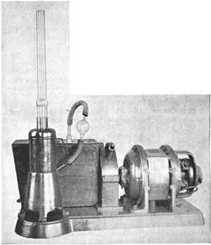 Diffusion pump - Early Langmuir mercury diffusion pump (vertical column) and its backing pump (in background), about 1920.  The diffusion pump was widely used in manufacturing vacuum tubes, the key technology which dominated the radio and electronics industry for 50 years.