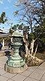 Lantern and Tree in Kōtoku-in, Kamakura.jpg