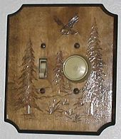 Mercury Light Switch: Two light switches in one box. The switch on the right is a dimmer switch.  The switch box is covered by a decorative plate.,Lighting