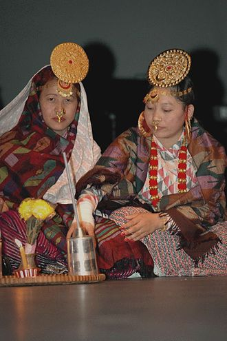 Limbu people - Limbu women with traditional clothing and traditional tongba drink.