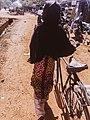 Little girl pushing her bike.jpg