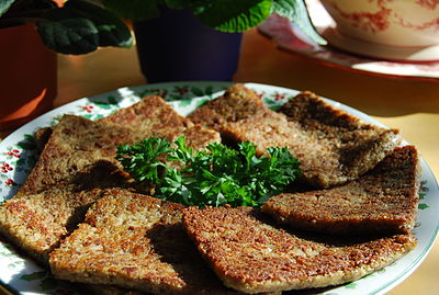 A pound of sliced, pan-fried livermush, garnished with parsley