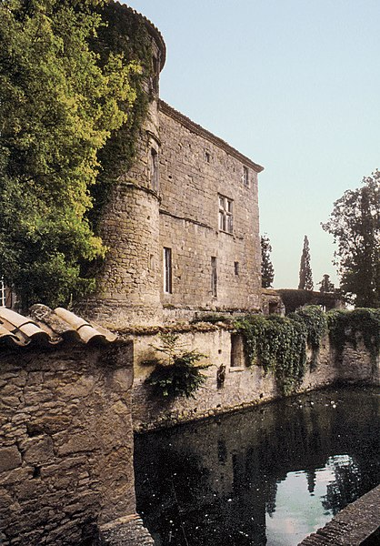 Castle of Loubens-Lauragais, Midi-Pyrénées, France. The high west walls plunge into a pond, remains of the original moat.