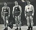 Louis Hostin Champion olympique 1936 d'halthérophilie (G. l'égyptien Wasil 3e; D. l'allemand Deutsch 2e).jpg