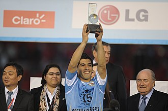 Sepp Blatter - Blatter (right) with Luis Suárez, the Player of the Tournament of the 2011 Copa América.