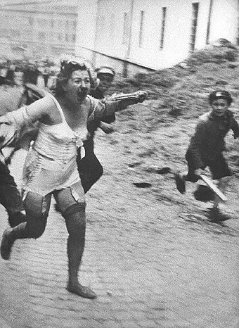 Jewish woman chased by men and youth armed with clubs during the Lviv pogroms, July 1941, then occupied Poland, now Ukraine Lviv pogrom (June - July 1941).jpg