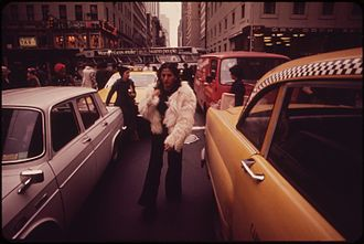 Jaywalking - Jaywalkers cross a congested street in Midtown Manhattan, 1973