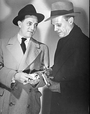 Counterspy (radio series) - The radio program also found its way onto television.  Pictured are Mendell Kramer as Peters (left) and Don McLaughlin as David Harding in 1952.