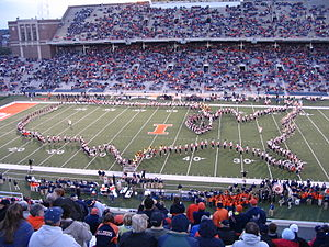 Marching band - The Marching Illini, the first band to perform a halftime show at an American football game