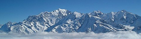 Mont Blanc, the highest summit in Western Europe, marks the border with Italy. Massif du Mont-Blanc (hiver panoramique).jpg