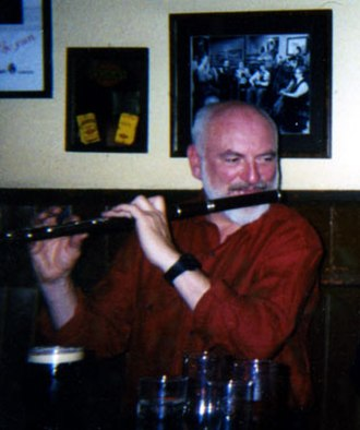 Irish flute - Matt Molloy playing flute in Westport in March 2000.