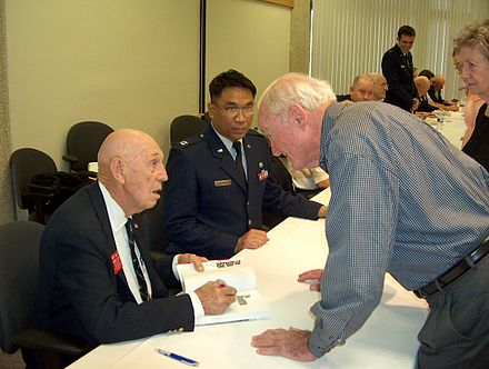 WWII Army veteran George A. McCalpin (right) talking to Lt. Col. Richard E. Cole (seated) about McCalpin's cousin, raider Sgt. William 'Billy Jack' Dieter, at the 66th anniversary reunion at the University of Texas at Dallas in April 2008 McCalpin and Cole 66th anniversary.jpg