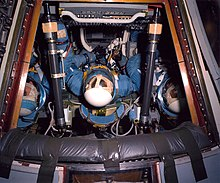 Apollo command module with men inside