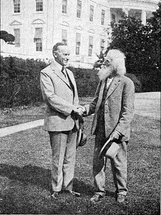 Oregon Trail Memorial half dollar - Meeker with President Calvin Coolidge