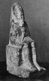 Statuette of a seated king holding a mace and wearing the long crown of Upper Egypt