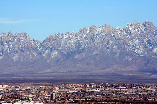 The Organ Mountains tower over the Mesilla Valley (Las Cruces, NM in the foreground). MesillaValley Organs.jpg