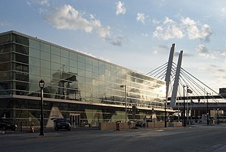 Milwaukee Intermodal Station - Glass station building and 6th Street Bridge at sunset