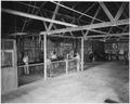 Mission shop, Viejas. (Interior view showing men at equipment.) - NARA - 295140.tif