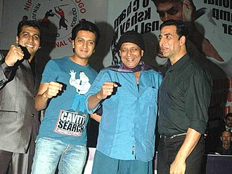 Mithun Chakraborty - Since 2009, Chakraborty and Akshay Kumar have starred together in several films. Pictured above are (r - l) Kumar, Chakraborty and Riteish Deskmukh at a Karate event.
