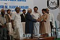 Mohd. Hamid Ansari presenting the Prof. N.A. Karim award for out standing public service to Shri Rajagopal at Thiruvananthpuram, Kerala. The Chief Minister, Kerala, Shri Oommen Chandy and other dignitaries are also seen.jpg