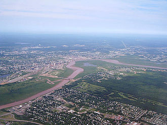 Moncton - Moncton is located along the north bank of the Petitcodiac River, at a point where the river bends acutely from a west-east to north-south flow.
